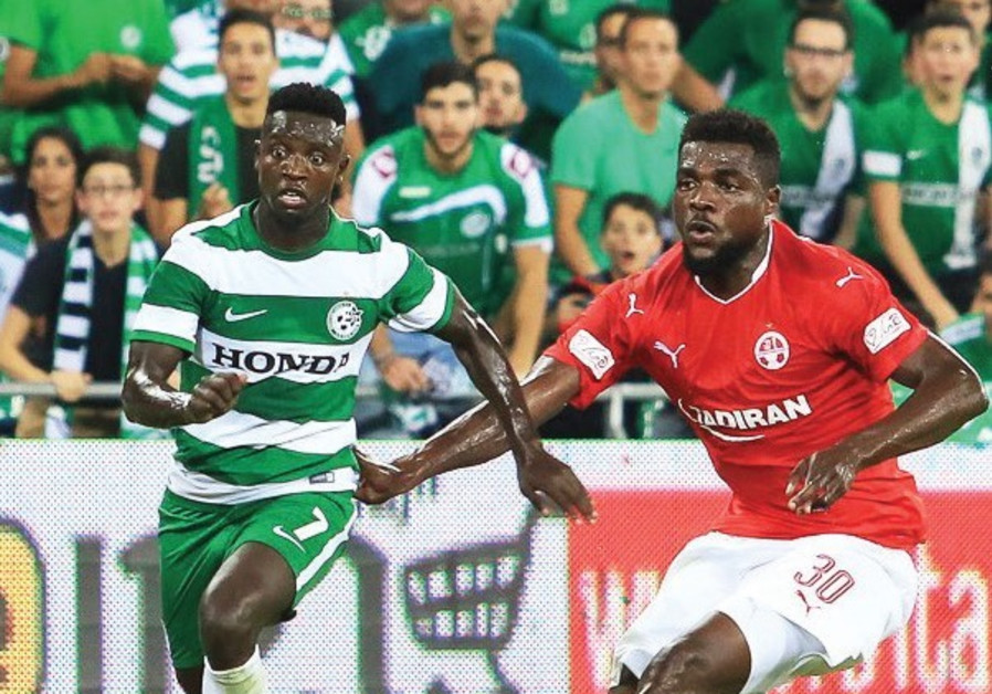 New Maccabi Haifa winger Sintiyahu Salalik (left) races past Hapoel Beersheba's John Ogu during last