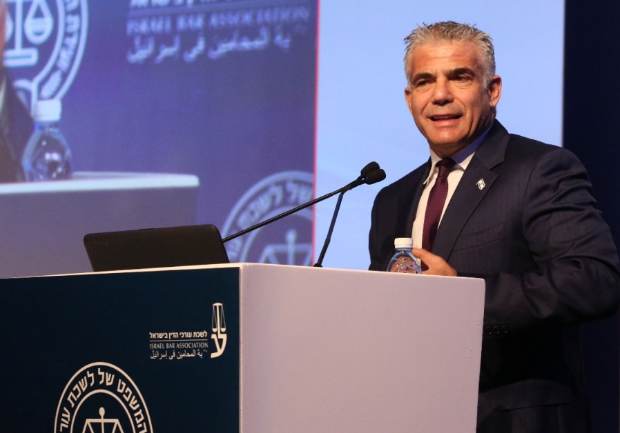 Yair Lapid speaks at a conference