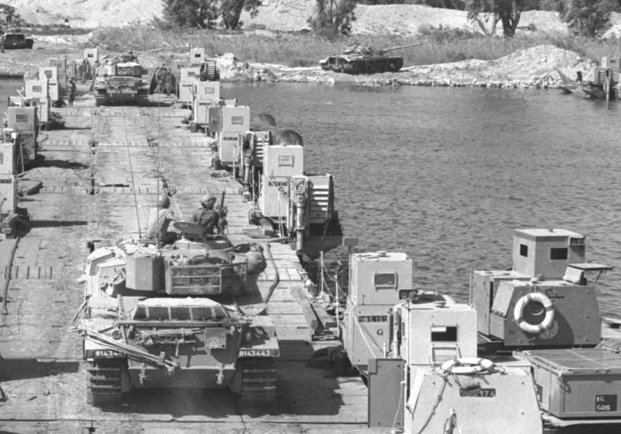 TANK reinforcements crossing to the bridgehead on the west bank of the Suez Canal