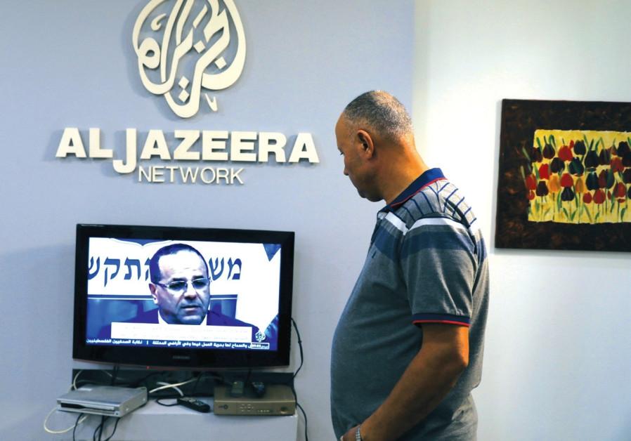 AN EMPLOYEE working inside the office of Qatar-based Al- Jazeera network in Jerusalem