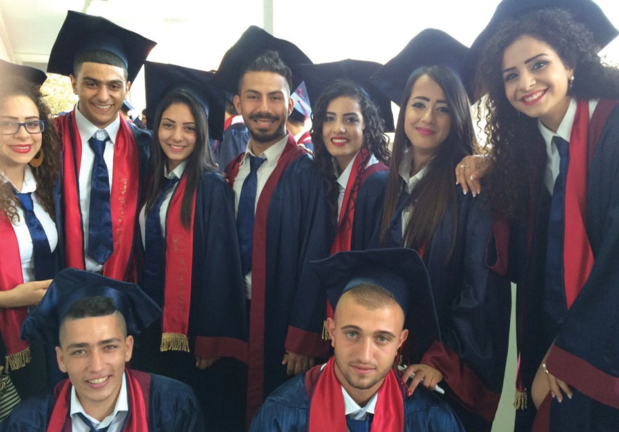 High school graduates celebrate receiving their diplomas in Kafr Yasif last year.