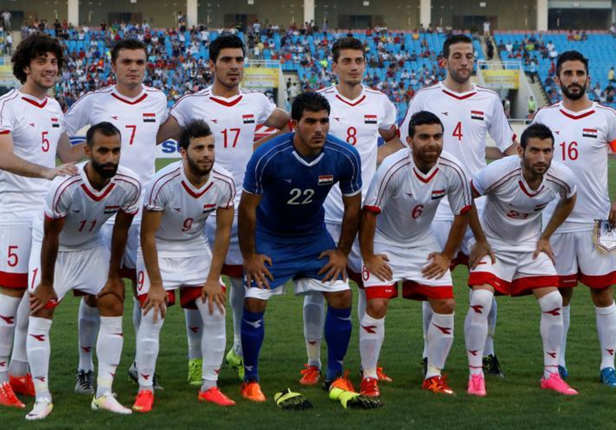 Syria's soccer team players pose for a photo before a friendly match against Vietnam.