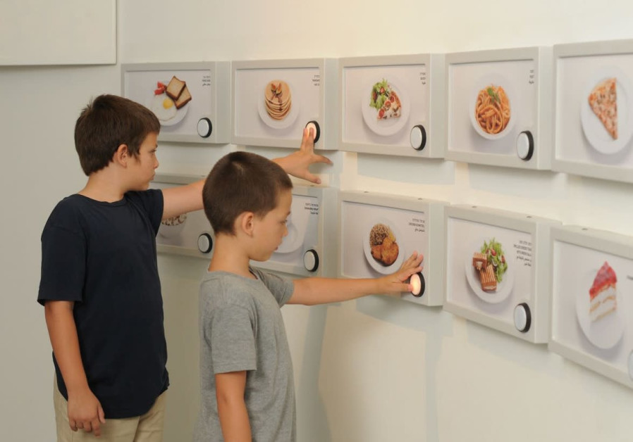Children enjoy an interactive exhibit at the Carasso Science Park. (