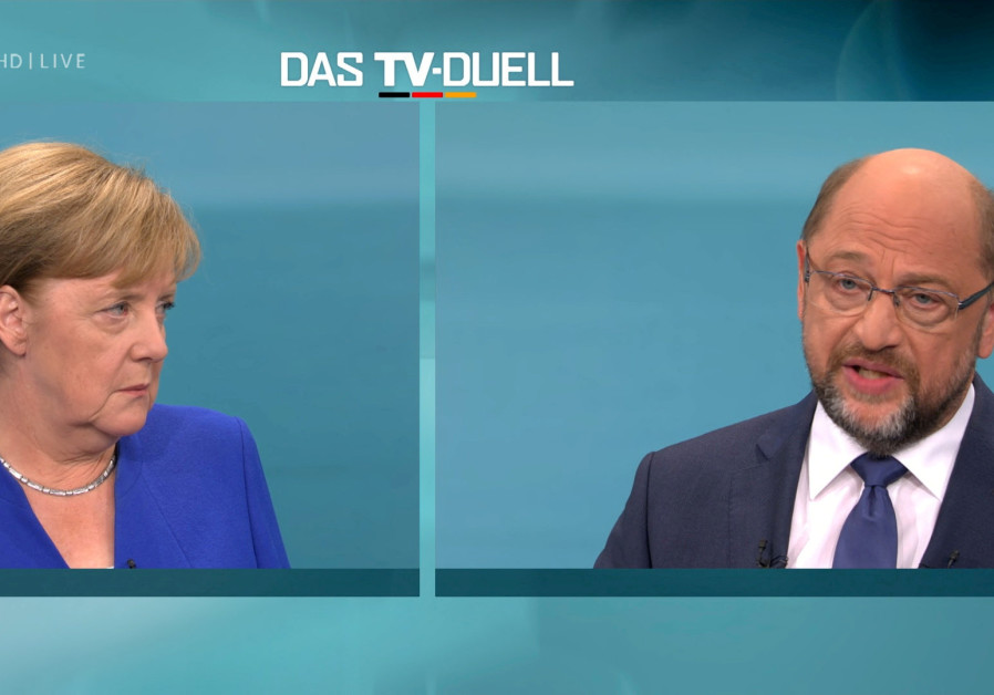 A screen shows the TV debate between German Chancellor Angela Merkel of the Christian Democratic Uni