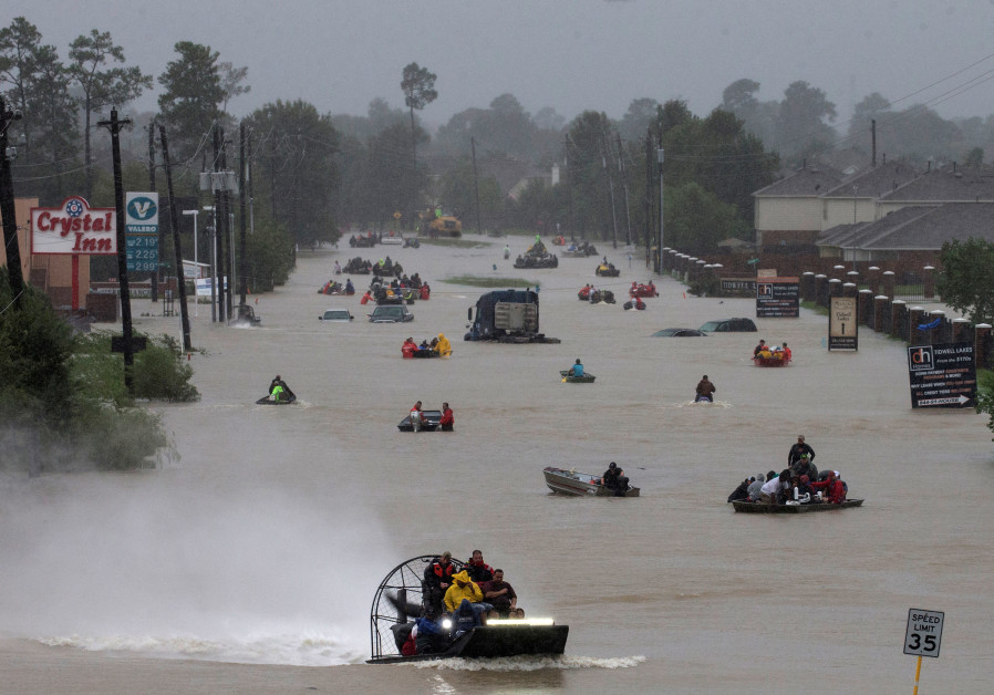 Residents use boats to evacuate flood waters from Tropical Storm Harvey along Tidwell Road east Hous