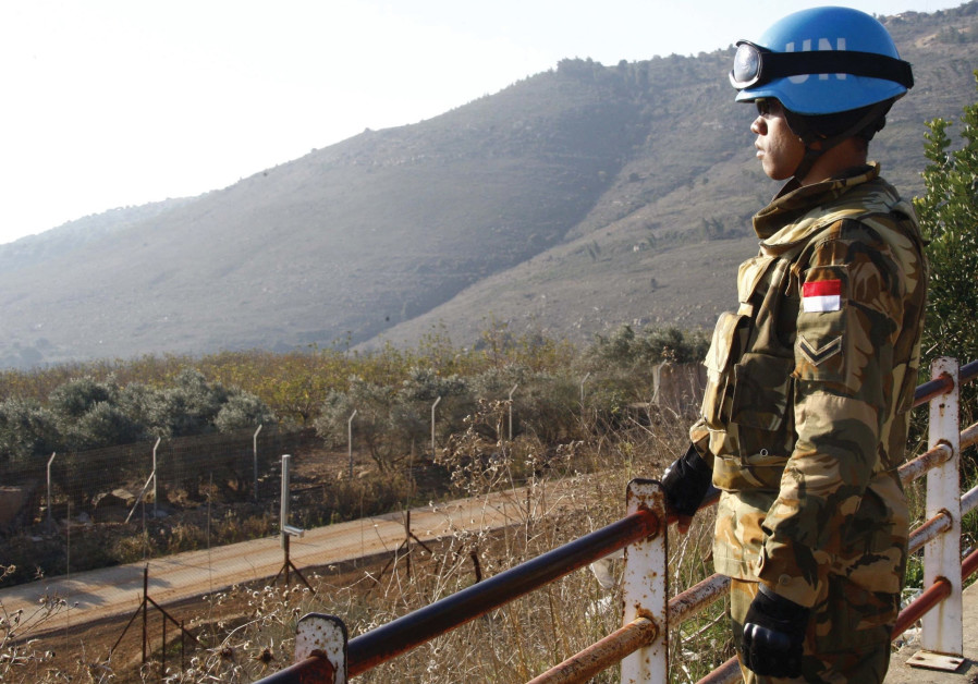 A PEACEKEEPER of the United Nations Interim Force in Lebanon (UNIFIL) stands at a lookout point