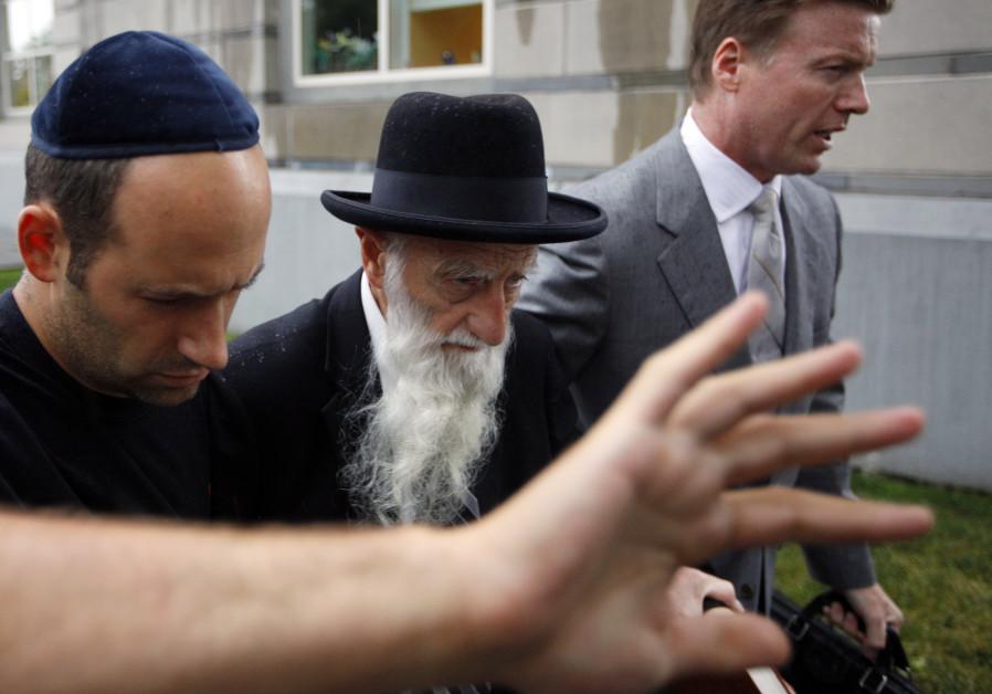 Rabbi Saul Kassin (C), the chief rabbi of a synagogue in Brooklyn, N.Y., exits federal court after b
