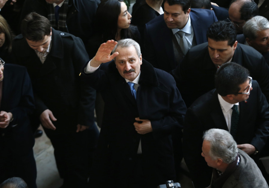 Turkey's former Economy Minister Zafer Caglayan waves as he arrives at a handover ceremony in Ankara