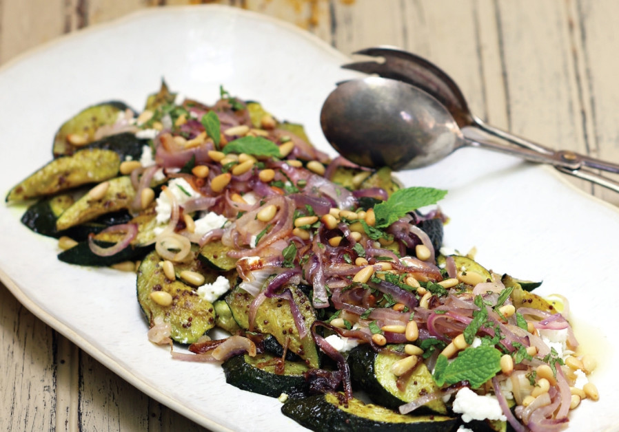 Roasted Middle Eastern-style zucchini with caramelized onions, feta, and pine nuts