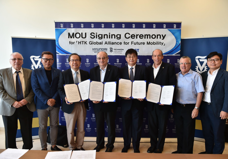 TECHNION PROFESSORS, including Prof. Daniel Weihs (left), sign a memorandum of understanding with pa