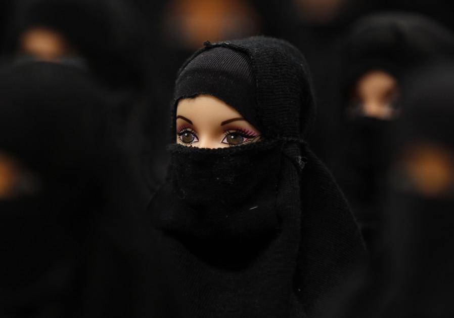 A German art installation showing 100 Barbie dolls with burkas, 2012