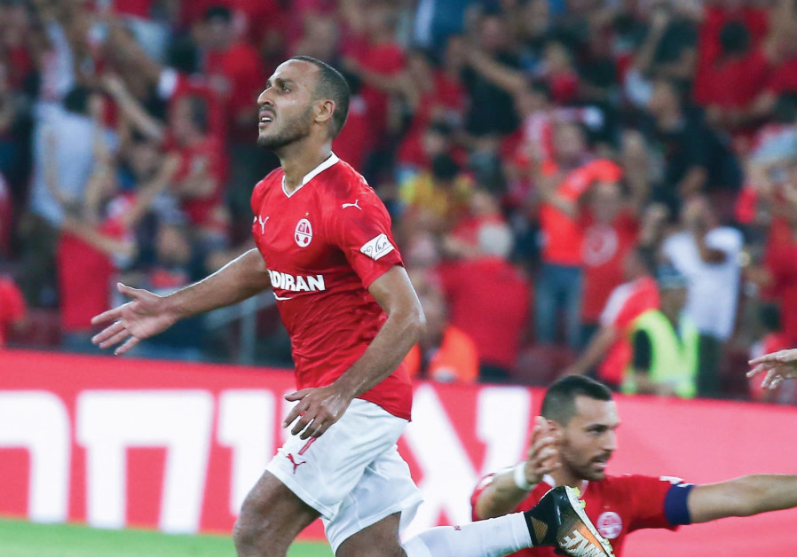 Hapoel Beersheba midfielder Maharan Radi (left) celebrates after scoring.
