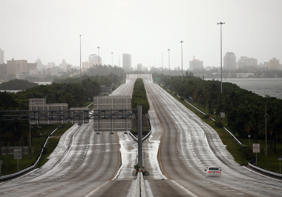 A car drives along an empty highway in Miami before the arrival of Hurricane Irma in south Florida