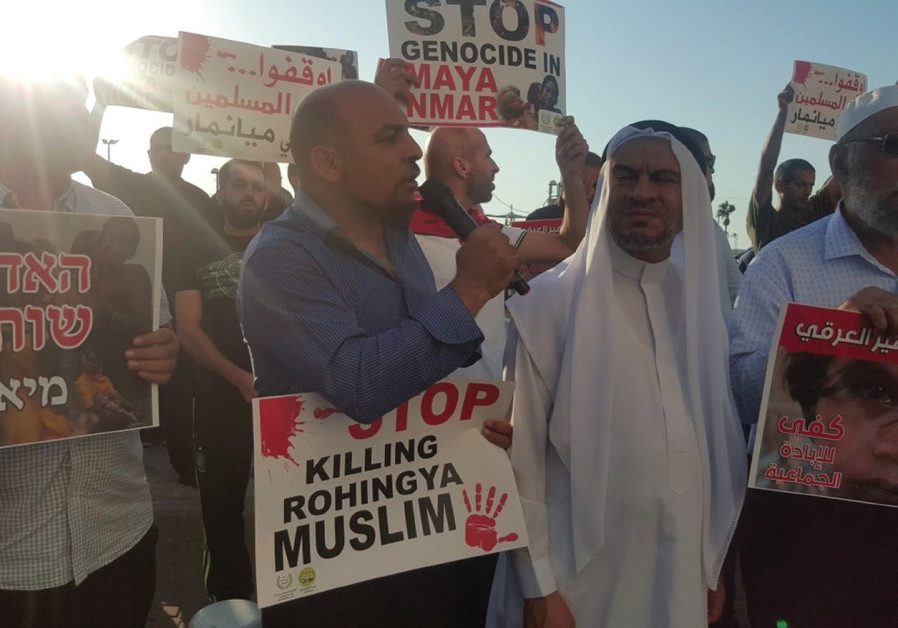 MK MASOUD GNAIM (center) participates in a protest against the killing of his Rohingya Muslim 'broth
