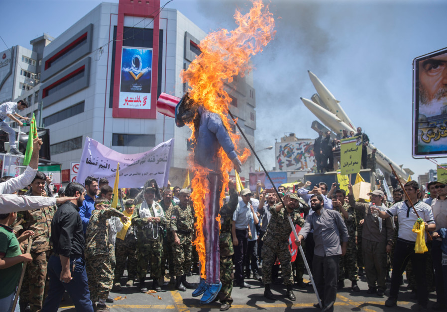 A scarecrow model is set on fire by Iranian demonstratorson during the annual pro Palestinian rally