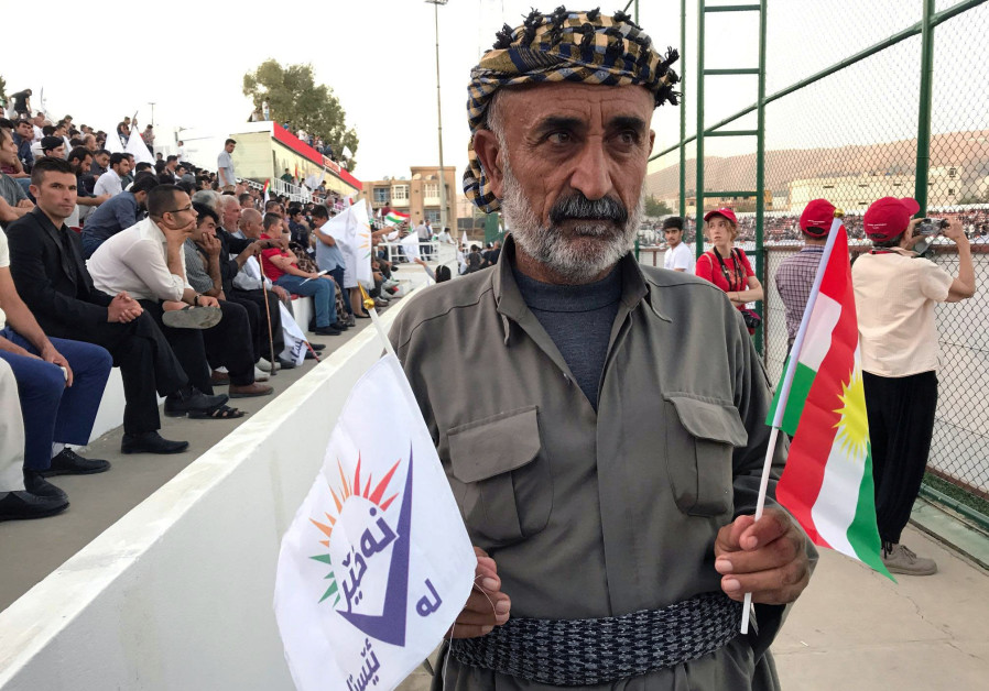 "A supporter of the ""NO For Now"" movement attends a rally calling on Iraqi Kurds to vote against the"