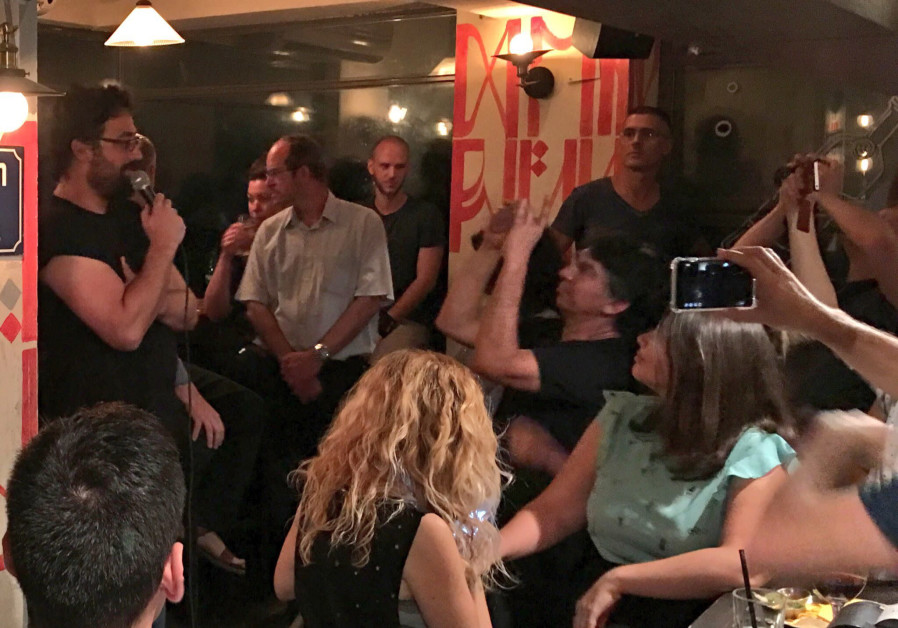 Lior Meiri (far left) speaking at a Tel Aviv bar at a New Likudniks event in September.