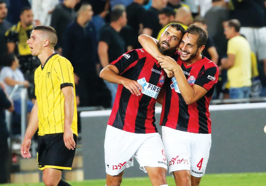 Hapoel Haifa striker Eden Ben-Basat (center) celebrates with teammate Dor Malul.