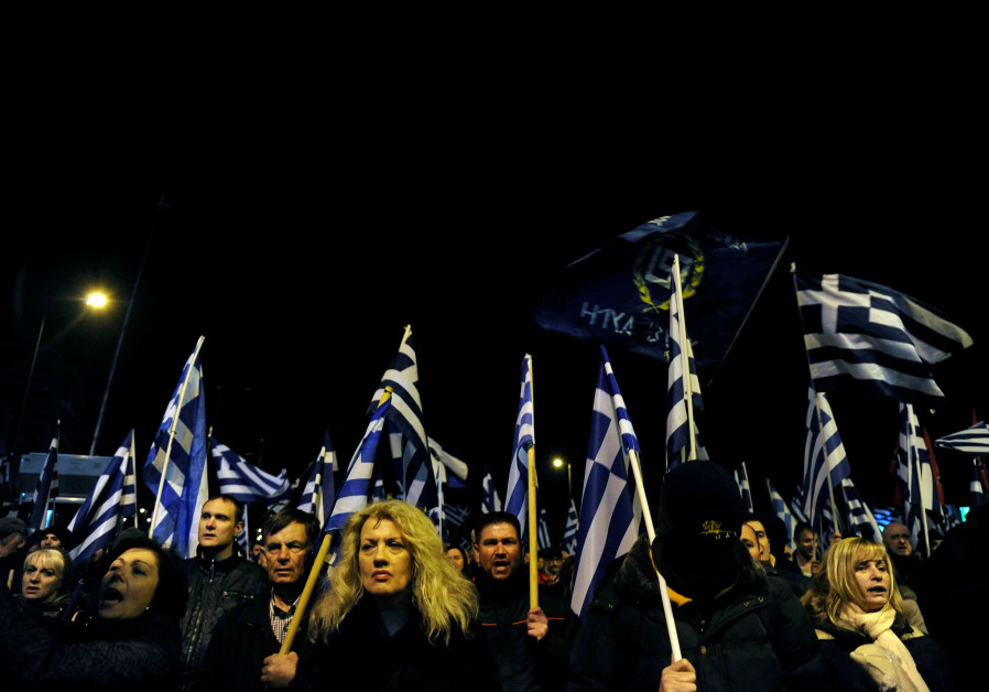 Supporters of Greece's far-right Golden Dawn party shout slogans as they wave national and party fla