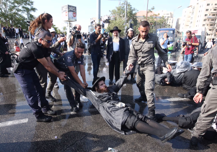 Israeli police breaking up an ultra-Orthodox protest in Jerusalem, September 17, 2017.