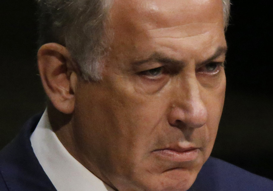 Israeli Prime Minister Benjamin Netanyahu pauses while addressing attendees during the 70th session