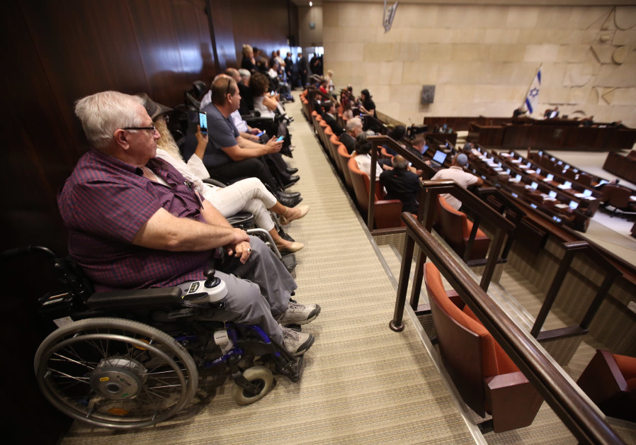 Disabled activists sit in at the Knesset plenum discussing goverment allowances for the disabled