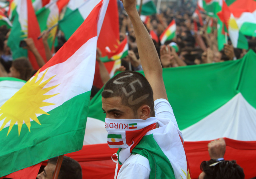 Kurds attend a rally to show their support for the upcoming September 25th independence referendum i