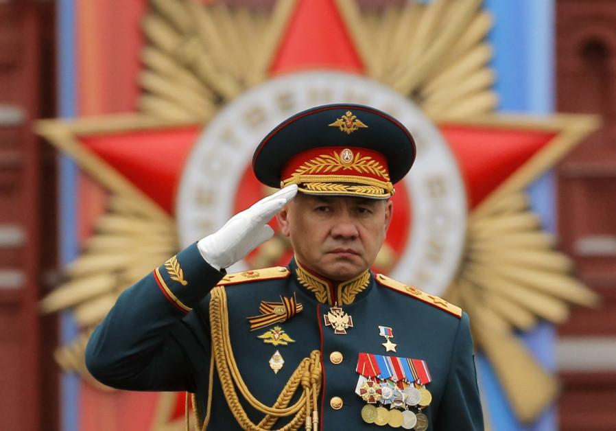 Defense Minister Sergei Shoigu salutes