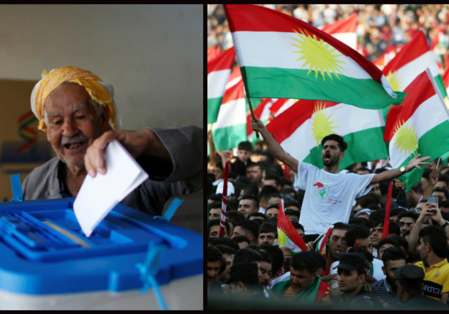 A man casts his vote during Kurds independence referendum in Erbil, Iraq September 25, 2017, beside
