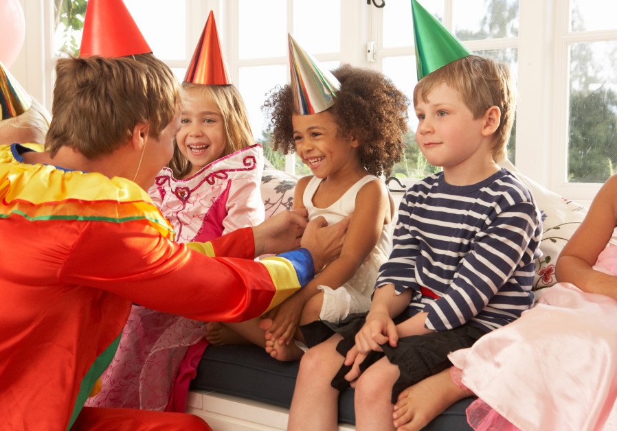 clown entertaining children at a party