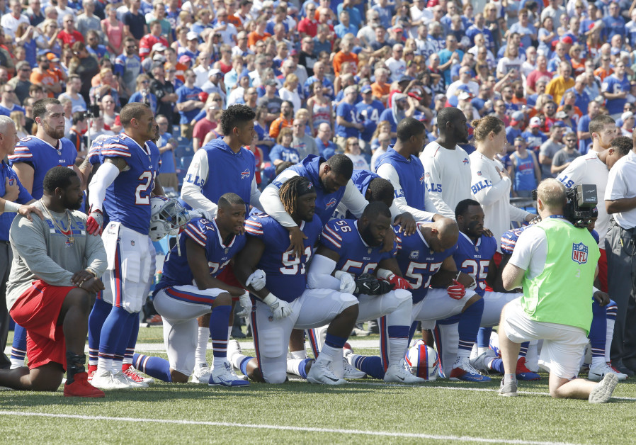 Buffalo Bills players kneel in protest during the anthem before a game against the Denver Broncos