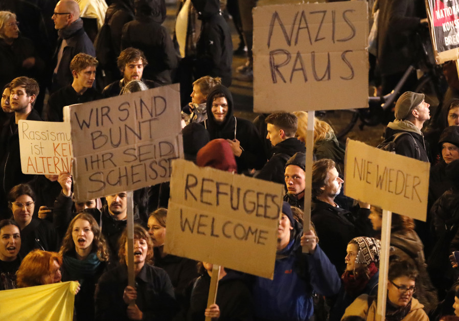 Demonstrators protest the anti-immigration party Alternative fuer Deutschland (AfD) after elections