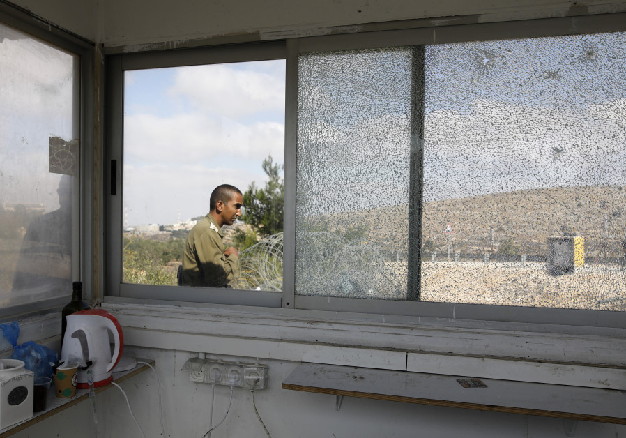 IDF soldier outside location of terror shooting at a security booth in West Bank town of Har Adar, S