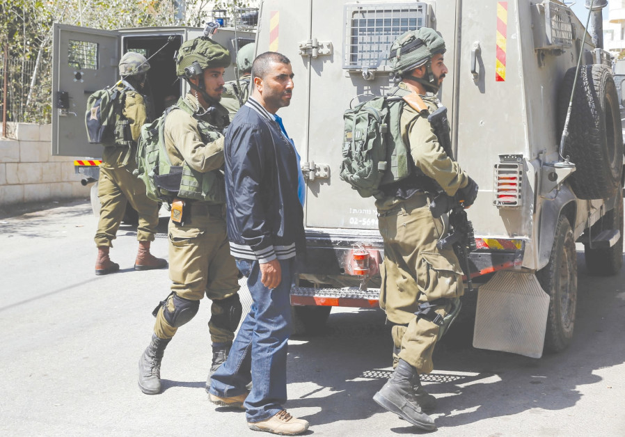 Har Adar attack puts Palestinians who work in settlements under scrutiny