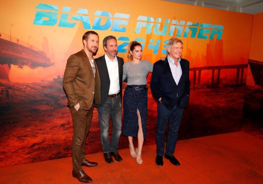 Director of the movie Denis Villeneuve (2ndL) and cast members Ryan Gosling (L), Ana de Armas (2ndR)