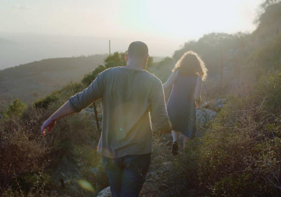 Gili (Udi Razzin) and Ya'ara (Noa Koler) scout the location where they plan to build their dream hom