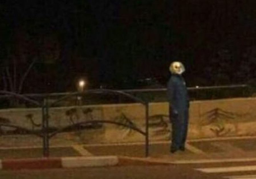 Israel Police detain minor in clown mask