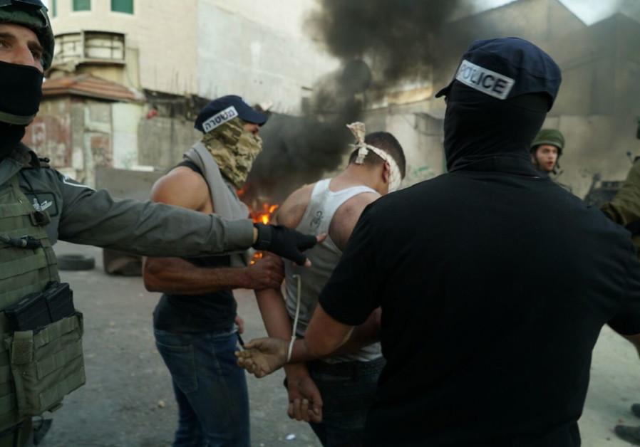 Border Police arrest Palestinians rioting in the West Bank village of Biddu, September 2017