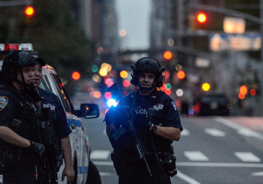 Members of the New York City police department stand guard amid heightened security during the Unite