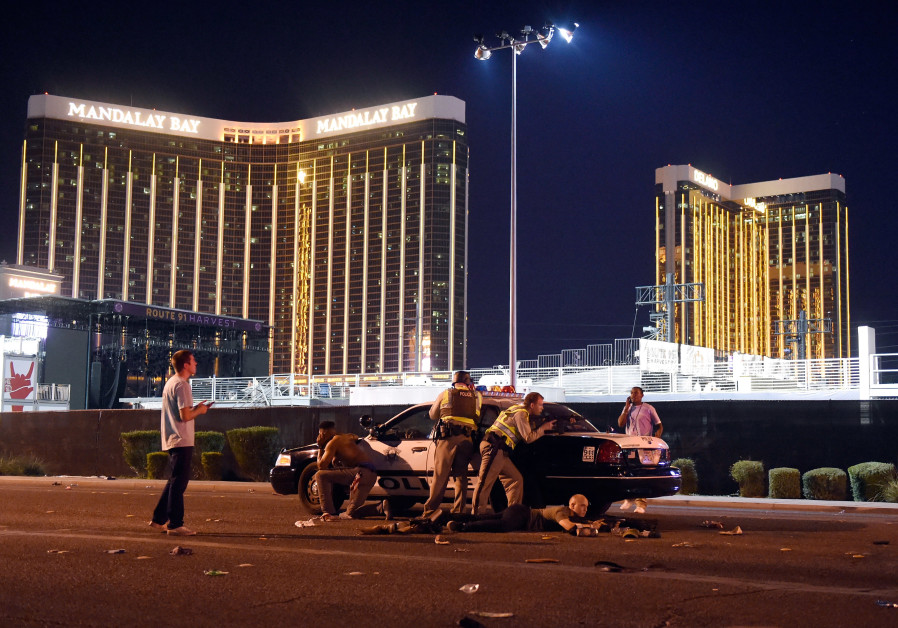 Las Vegas police stand guard outside the Route 91 Harvest country music festival after a shooting