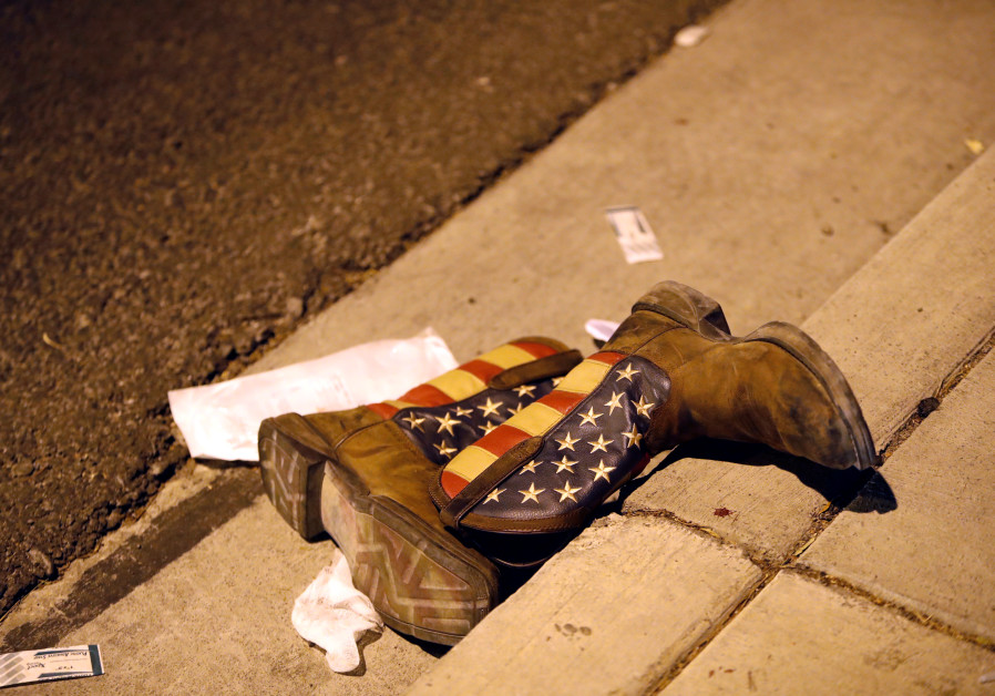 A pair of cowboy boots in the street outside the concert venue after a mass shooting in Las Vegas, N