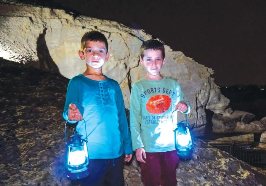 VISITORS to the Rosh Hanikra grottoes are given lanterns for night tours and experience a unique lig