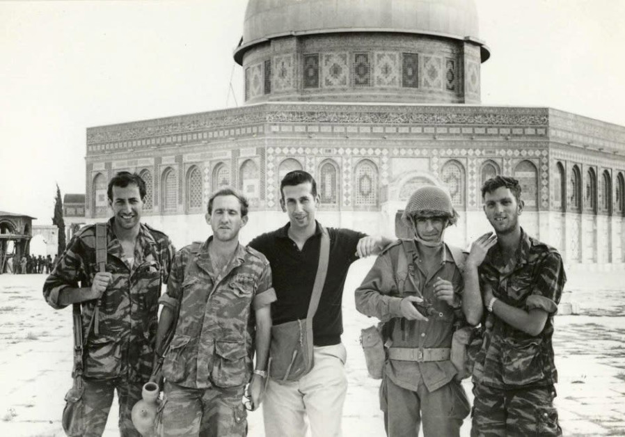 THE AUTHOR, Abraham Rabinovich, poses for a photo with IDF soldiers atop the Temple Mount in June 19