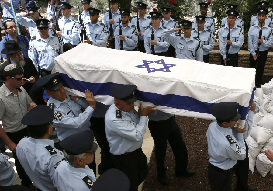 Israeli police officers carry the coffin of slain Chief Superintendent Baruch Mizrahi
