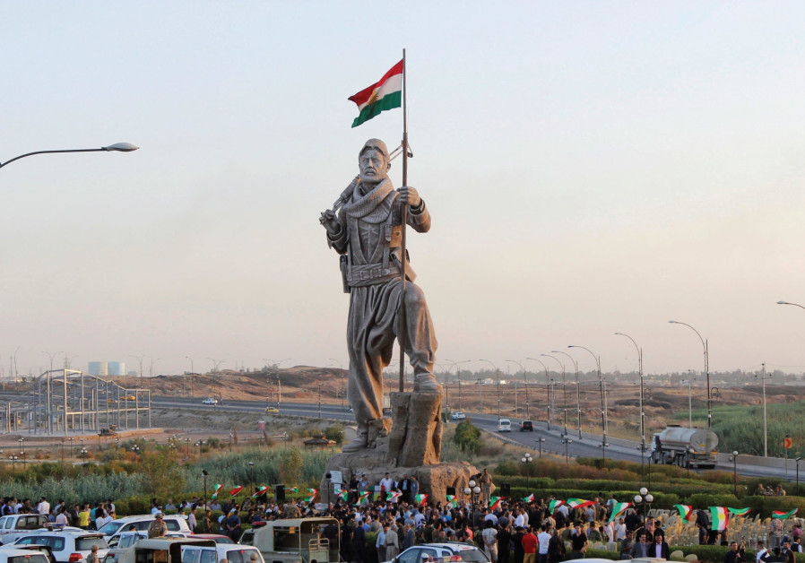 A STATUE of a Peshmerga fighter