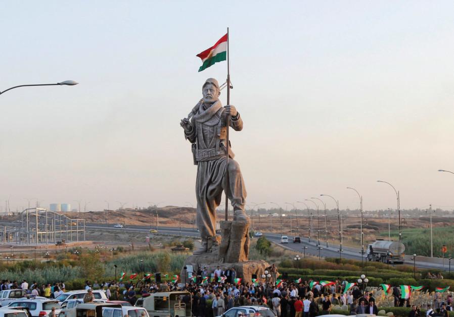 A STATUE of a Peshmerga fighter