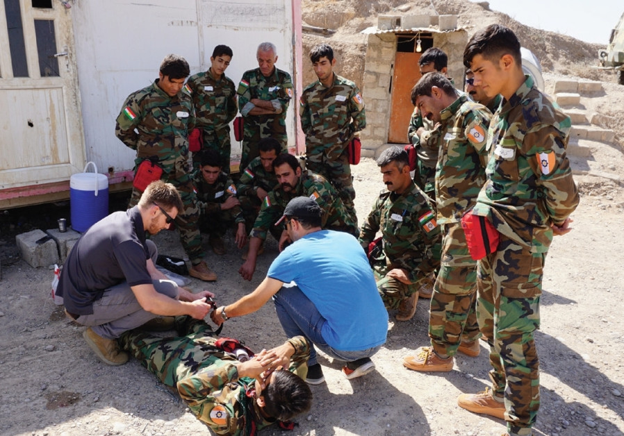 The American Christian aid volunteers giving Kurdish Peshmerga medical training