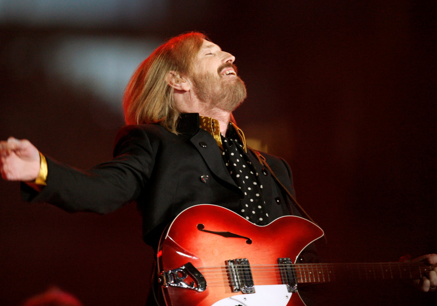 Singer and songwriter Tom Petty performs during the half time show of the NFL's Super Bowl XLII foot