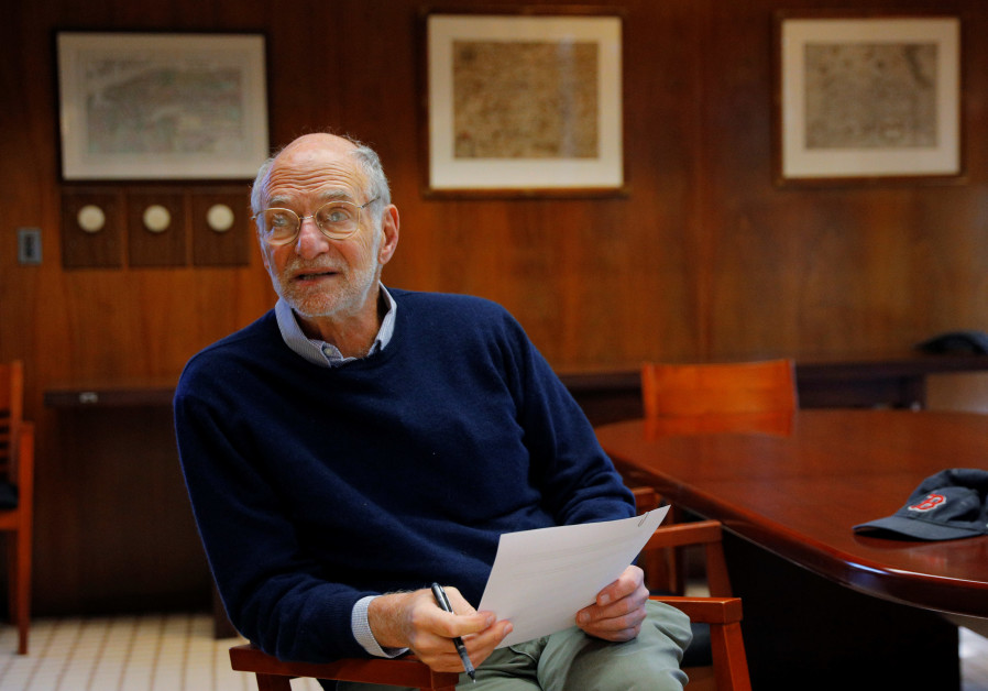 Michael Rosbash, a Brandeis University professor, proof-reads a press release after being named as a