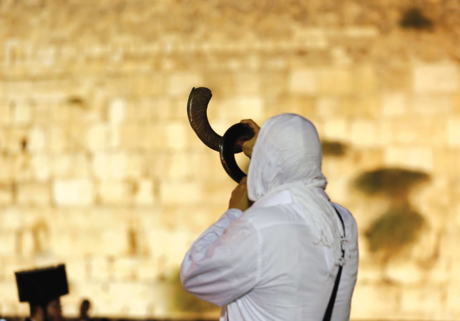 A Jewish man praying at the Western Wall